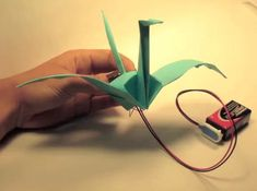 Electronic Origami Flapping Crane w/ tutorial. This is a simplified version of the SMA flapping crane.  When you pinch the tail, the wings c...