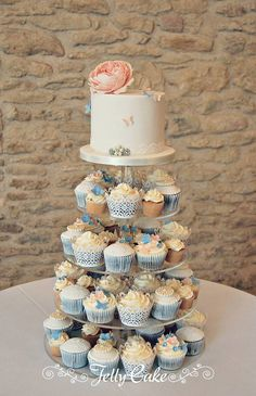 A pretty peach, blue and lacy cupcake tower for one of today's weddings. A sugar rose with blue and peach butterflies on the top cake with a variety of cupcakes. All set up at the lovely The Kingscote Barn - Wedding venue. Wedding Shower Cupcakes, Cupcake Tower Wedding, Heart Wedding Cakes, Wedding Cups, Wedding Cakes With Cupcakes, White Wedding Cakes, Cool Wedding Cakes, Wedding Cake Toppers, Wedding Ideas