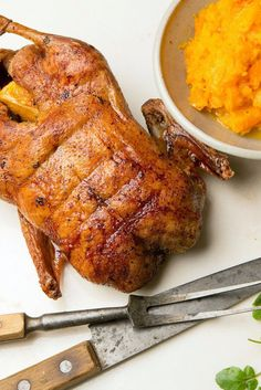 NYT Cooking: For a festive occasion, a burnished whole duck makes quite an impression — fancier than chicken and more elegant than turkey. Roasting the duck is not so difficult to do, but it can be smoky Meat Recipes, Chicken Recipes, Cooking Recipes, Game Recipes, Whole Duck Recipes, Mashed Butternut Squash, Roast Duck, Roasted Turkey, Asian