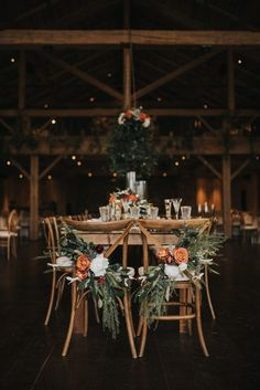 The Design Eye Candy Doesnt Quit in This Devils Thumb Ranch Wedding These rustic wooden chairs are decorated with lush greens orange flowers Fall Wedding Centerpieces, Wedding Flower Arrangements, Flower Centerpieces, Centerpiece Ideas, Autumn Wedding Decorations, Autumn Wedding Ideas, Autum Wedding, Fall Wedding Table Decor, Unique Centerpieces