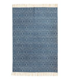 Check this out! Rectangular rug in woven cotton fabric with a printed pattern at front. Fringe at short sides. - Visit hm.com to see more.