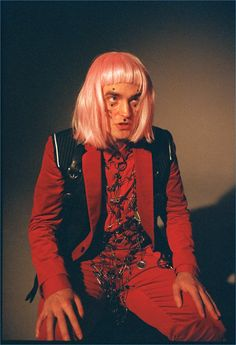 Sporting a pink wig, Robert Pattinson stars in a photo shoot for Wonderland.