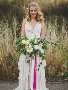 Boho wedding dress + bright ribbon bouquet
