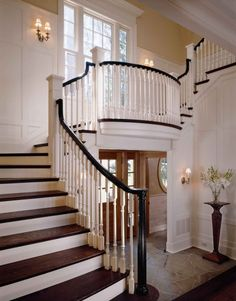 Black painted handrails...elegant staircase and landing. www.askamyinc.com