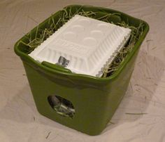 Awesome idea for a feral cat shelter... a tub with a styrofoam cooler inside! (From Rubbermaid)