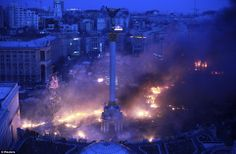 Smoke rises above Independence Square during anti-government protests in central Kiev in the early hours of yesterday morning