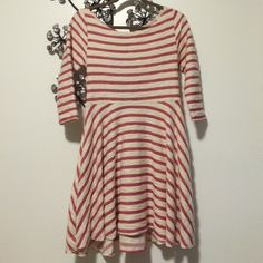 Free People Striped Dress NWOT Free People pink and ivory striped dress! It has back cut outs and 3/4 length sleeves. Free People Dresses Long Sleeve