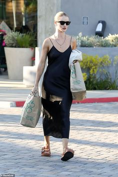 Rosie Huntington-Whiteley shows off her enviable figure in silk slip Stylish: Rosie Huntington-White Rosie Huntington Whiteley, Rose Huntington, Fashion Outfits, Womens Fashion, Fashion Trends, Fashion Blouses, Fashion Boots, Silk Slip, Models Off Duty