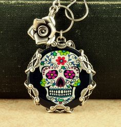 Sugar Skull Necklace Black Day of the Dead Necklace Goth Halloween Necklace Gothic Dia de los Muertos Rose Sterling Silver Necklace Filigree. $43.00, via Etsy.