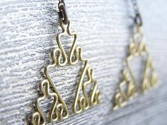 Just bought these from DragonNerd on Esty.  Fractal Earrings - Sierpinski Triangles in Brass.  They've got lovely geek chic wire jewelry made in the 'Peg.