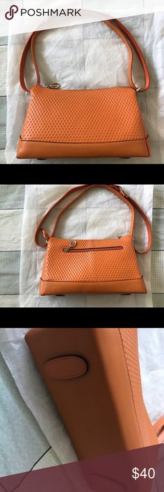 Diguolaotou orange bag Diguolaotou orange bag with dust bag.  There is a small damage in the bottom please look at last picture. Measurement:  Length: 10.5in Width: 3.5 in Height: 7 in Diguolaotou Bags Shoulder Bags