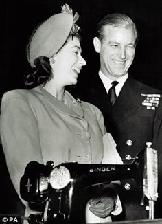Princess Elizabeth (later Queen Elizabeth II) and Lieutenant Philip Mountbatten with a Singer Sewing machine. S)