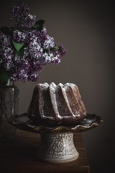 A family recipe for a simple, moist chocolate zucchini cake. Made delicious by the addition of grated zucchini, oil and buttermilk and finished with either powdered sugar or a cream cheese frosting. Cocoa, Cinnamon Scones, Dark Food Photography, My Dessert, Dessert Ideas, Zucchini Cake, Cake Tins, Cake Batter, Cookies
