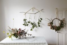 """Foraging for foliage is a noble Christmas tradition, and one that London florists Worm (otherwise known as Terri Chandler and Katie Smyth) are perfectly suited to. """"We are not very neat humans,"""" admits Katie. """"There is no point in us . Hygge Christmas, Rustic Christmas, Christmas Wreaths, Christmas Decorations, Flower Installation, Light Garland, Hanging Flowers, Christmas Projects, Christmas Ideas"""