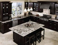flooring with black cabinets; gray tile