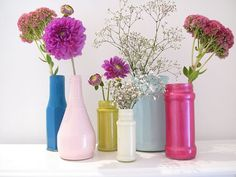 bottles and vases with acrylic paint in them. (by cheap bottles at dollar store, rumage sales, thrift stores or save your IZZY or glass Soda bottles for this)