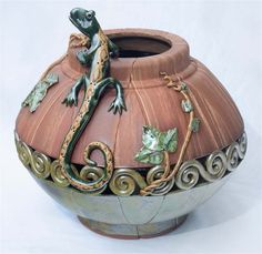 "Artist: Jennifer Beville - "" Lizard Garden Lantern: Hand built clay using slab and coil techniques. This is a garden lantern for outdoor decorating. It is 18""x 20""  #artsintheheart #pottery"