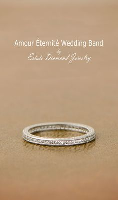 A stunning vintage style wedding band, inspired by the French Art Deco Era. Beautiful etchings are carved along the sides.