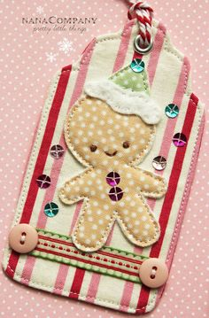 gingerbread man is fabric on felt appliqued.