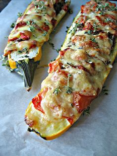 zucchini boats stuffed with ground meat, seasoning, and cheese