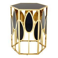 Hexagonal gold finish table with art deco leaf frame and glass table top.  Taking its name from the Neo-Baroque splendour and the modern art of Venice's iconic 1700s Caffè Florian, the Eichholtz Florian Side Table is a fitting addition for your glamorous interior space.