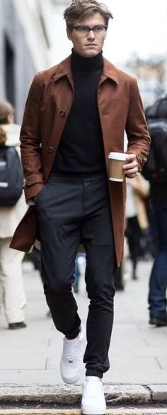Fall combo inspiration with a black turtleneck burnt orange trench coat gray trousers white sneakers. Fashion Mode, Urban Fashion, Fashion Brands, Mens Fashion, Kenneth Cole Sneakers, Hipster Graphic Tees, Grey Trousers, Sneakers Fashion, Men's Sneakers