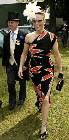 Zara Phillips at the Royal Ascot, March 2003.  She wore something very strange here, too much hat and not quite enough dress, and that Club Tropicana print is migraine-inducing. Ankle-strap shoes are unforgiving even on toned legs like her.