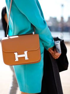 Hermes Constance in gold leather.
