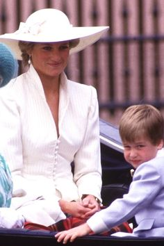 Diana, Princess of Wales rides in a carriage with her son, Prince William at Trooping the Color on June 13, 1987