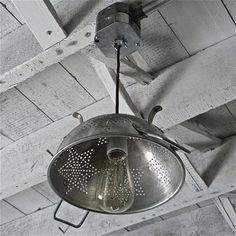 A vintage colander ceiling light! Love this. I want to make this w/ my grandmother's colander now. How special that would be. :-)