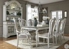 The Magnolia Manor 11 Piece Dining Set from Liberty Furniture brings you a classic look with a sophisticated-meets-rustic charm. This dining room furniture set comes in a white painted and distressed finish with a contrasting dark brown table top. White Dining Room Sets, White Dining Table, Dining Table In Kitchen, Dining Set, Shabby Chic Dining Room, French Country Dining Room, Elegant Dining Room, Beautiful Dining Rooms, Dining Room Furniture