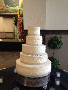 5 Tier Buttercream Wedding Cake with Dots, Scroll Work, and Rhinestone Ribbon