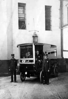 Los Angeles Police Department officers standing by their motor vehicle. Judging from the shape of their badges, I'm guessing that the photo was taken between 1903 and 1909. (LAPL)