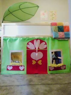 Ikea Kura Loft bed + a little felt = a cozy play cottage for Lucy.