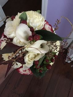 Winter white and burgundy wedding bouquet by Reynolds Treasures