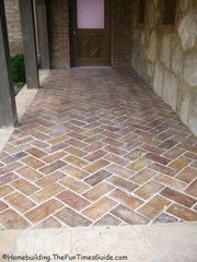 bricks laid in herringbone pattern on side porch by courtyard