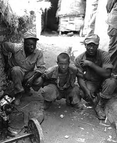 American soldiers pose with a captured North Korean soldier in August of 1950. After having been steadily pushed back by the invading North Korean forces, the combined forces of the United Nations made a stand in the southern corner of the Korean Peninsula, outside of Pusan. The DPRK onslaught was stalled despite repeated efforts to break through and throw the southern forces into the sea.