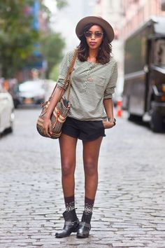 Taj in a Lifetime Collective top, H shorts, and Ecoute boots #streetstyle