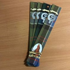 Pack of 5 clan bookmarks. All-over tartan image featuring your clan crest and reproduction of...