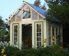Re-purposed windows and doors. My husband and I built this greenhouse using our collection of old windows and french doors. It has a cute chandelier inside and icicle lights that set it off at night. Recycled Door, Recycled Windows, Old Windows, Windows And Doors, Repurposed Doors, Salvaged Wood, Recycled Materials, Reclaimed Windows, Recycled House