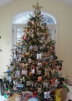 Christmas Tree with Cross Stitch Ornaments ~ Wonderful idea to create a country to primitive holiday look and display your handmade needlework.