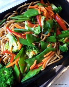 The Asian Noodles at The Bradley Kiosk in the Animal Kingdom. They are sweet, sour, and spicy with fresh broccoli, snow peas, carrots, and red pepper with a hint of sesame oil. The dish is garnished with black sesame seeds and green onion!