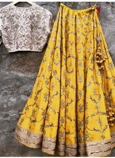 Buy gold raw silk with precipitant lace work & embroidery work designer lehenga choli online.It has matching gold lehenga in raw silk with beautiful embroidery all o Indian Lehenga, Raw Silk Lehenga, Yellow Lehenga, Red Lehenga, Anarkali, Bridal Lehenga, Lehnga Dress, Lehenga Blouse, Lehenga And Crop Top