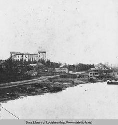 View of the Baton Rouge Louisiana riverfront and Old State Capitol in the 1870s :: State Library of Louisiana Historic Photograph Collection