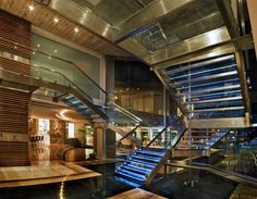 """This amazing modern mansion, dubbed """"Glass House"""" is located in Johannesburg, South Africa. It was designed by Nico van der Meulen Architects. It features square feet of luxurious living space with an open layout. Modern Interior Design, Interior Architecture, Interior And Exterior, Modern Interiors, Contemporary Architecture, Atrium, Glass Stairs, Modern Mansion, Staircase Design"""