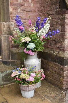 Country garden flowers in a milk churn for a eco friendly wedding / http://www.deerpearlflowers.com/rustic-country-milk-jug-wedding-ideas/