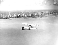 Biplane Pusher over downtown - Miami, Florida. 1930. State Archives of Florida, Florida Memory.