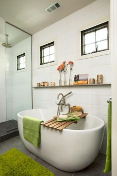 Budget-minded finishes in this bath include an aluminum picture rail, porcelain floor tile, a small acrylic tub, and oversize wall tile in an updated pattern.