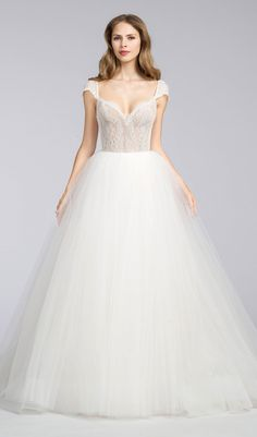 Try this ivory tulle wedding dress, chantilly lace bodice, sweetheart neckline wedding dress with cap sleeve, open low back, sweep train. From Jim Hjelm. Available at Schaffer's in Des Moines, Iowa. Wedding Dress Info: JIM HJELM – STYLE 8660.