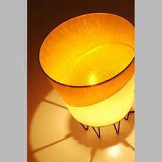 Greenlight Concepts 12 inch Yielding Yellow Bucket Lamp... the projection of light through the lens gives color to the shade.